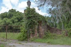 Long view of the Howey mansion gate arch